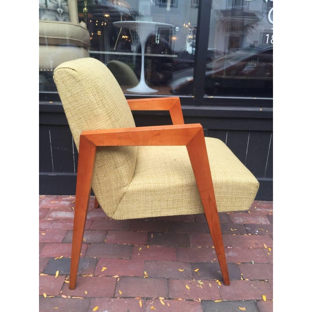 Armchair attributed to Robsjohn-Gibbings, with sleek sculptural blonde wood frame with new upholstery. Expertly finished.