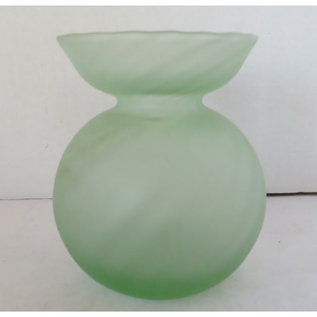 Soft green satin glass vase in globe shape with wide brim. The glass has a slight optic swirl effect. Made by Italian...