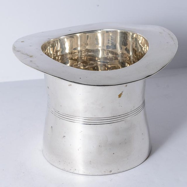 Rare Silver Plated Top Hat Champagne Bucket by Godinger. The plated silver champagne bucket is presented as a top hat,...