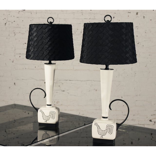 Just look at this handsome pair of Mid-Century Modern lamps with their eye-popping black and white coloration and the...