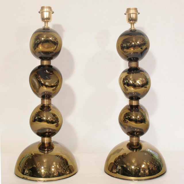 A pair of Unique blowned mirrored bronzed glass table lights, 3 spherical glass components on a large semi- spherical...