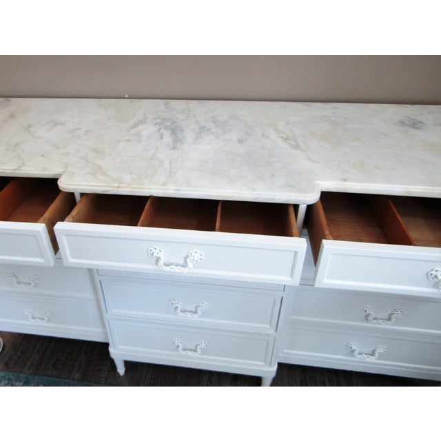 Gorgeous breakfront chest with twelve drawers, topped with marble. The top row of drawers have dividers. Well made, solid...