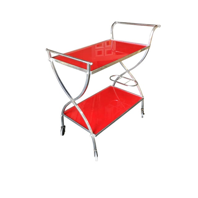 """Jacques Adnet Inspired Chromed Aluminum Bar Cart with red lucite shelf tops and crisscross """"X"""" patterns on each end. Circa..."""