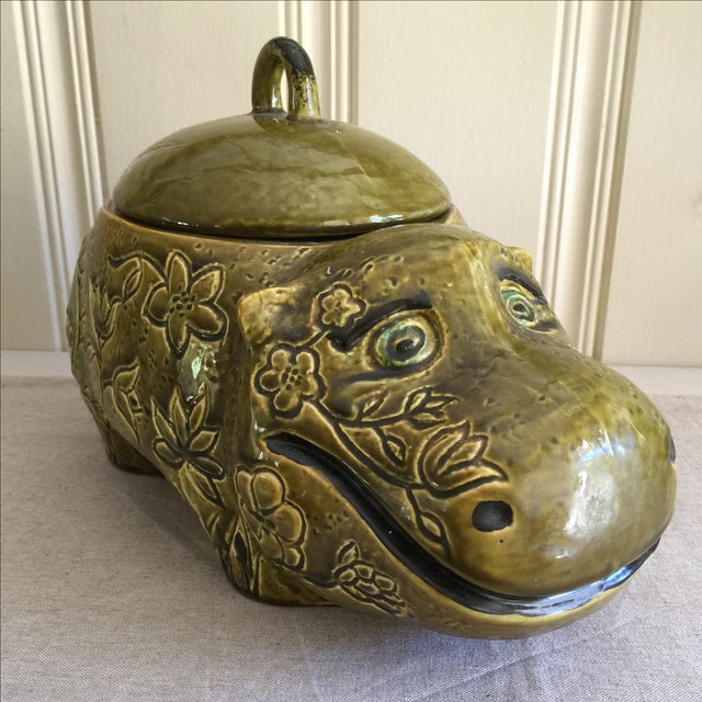 Fantastic anthropomorphic giant cookie jar. Olive green ceramic pottery canister with carved floral design and the cutest...