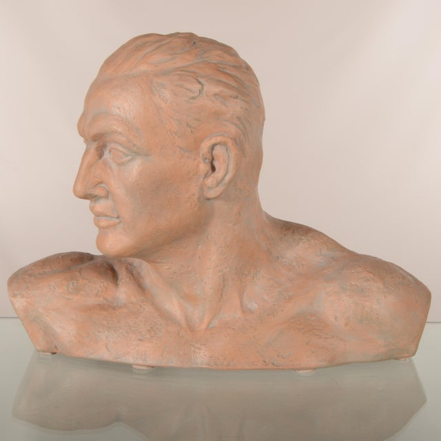 This handsome bust of a nude male was made in Italy. The figure is made of terracotta and is extremely well made. We love...