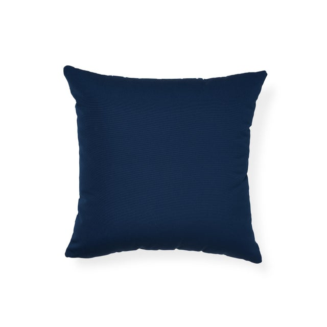 "The face of this 18"" x 18"" indoor/outdoor pillow features Iconic Leopard in Navy paired with Ravello in Indigo on the..."