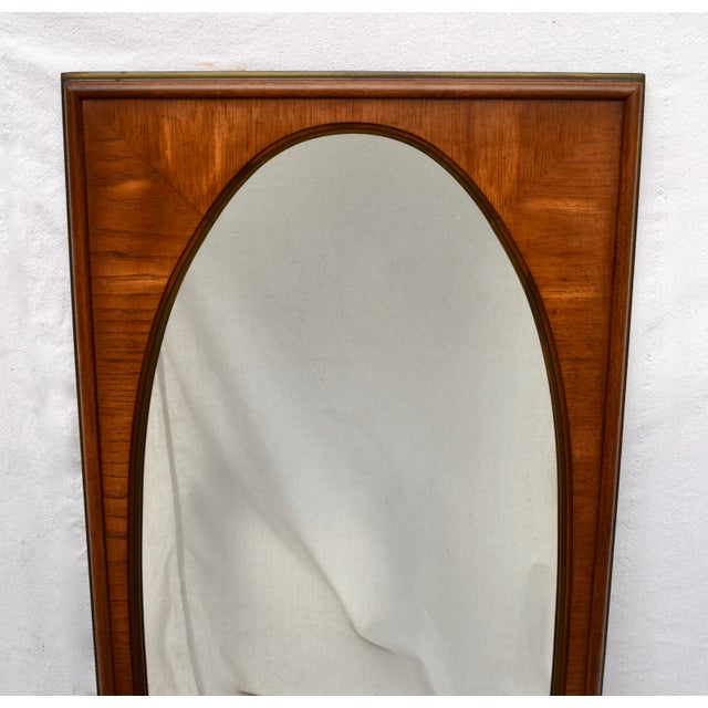 1950's pair of French Regency style oval mirrors by White Furniture Company of Mebane, NC. Striking striated wood grain...