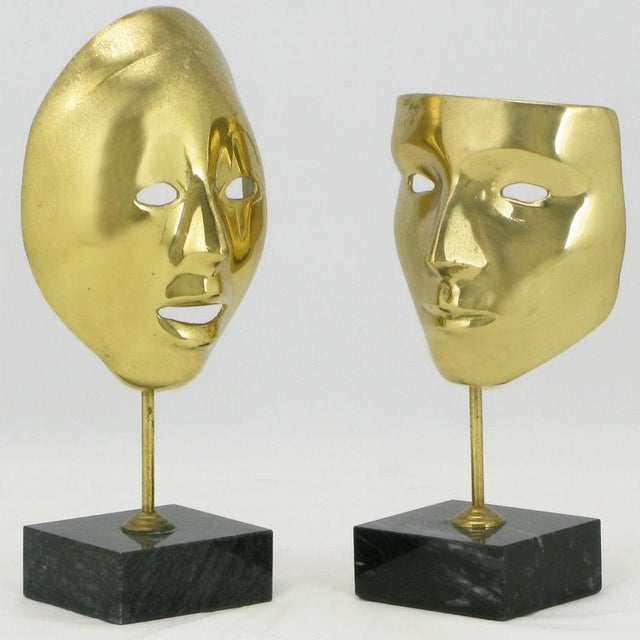 Equisite pair of cast brass Carnivale masks mounted on black marble plinth bases. Very nicely patinated.