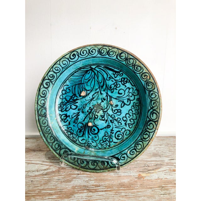 A Kushan turquoise plate from Central Asia, 13th Century. In archeological condition.