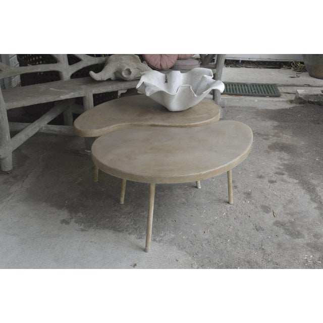 Cast concrete with aluminum legs. Interior and exterior. Color is hand finish and may vary. 7-8 week lead time for...