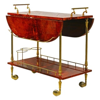 Lacquered Red Goatskin Parchment and Brass Drop Leaf Bar Trolley by Aldo Tura For Sale