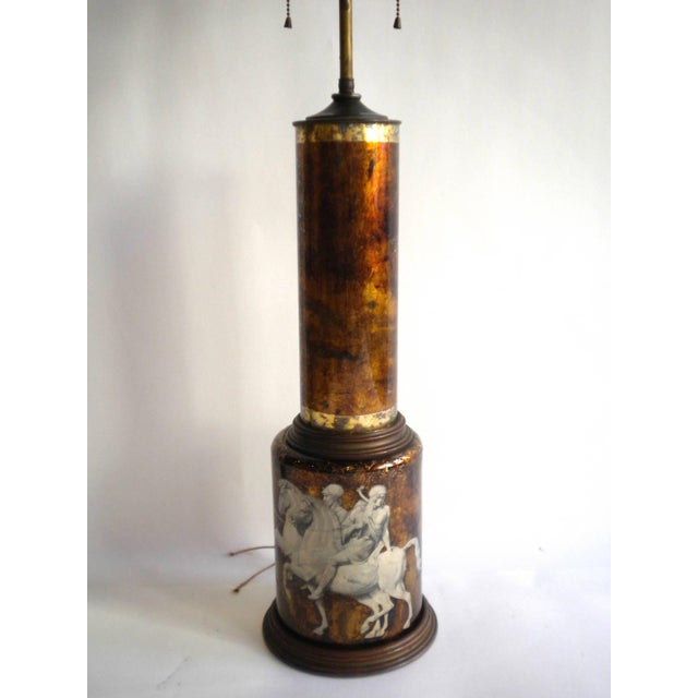 1950s églomisé lamp of classical figures mounted on brass base. Measure: Height to finial is 36 inches.
