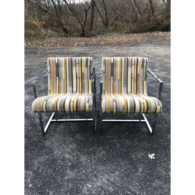 Chrome scoop chairs made by Silver-Craft. Both in great condition! Reupholstered in a textural cotton velvet. Very minor...