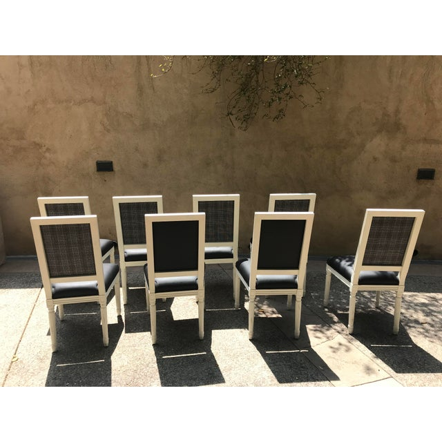 Black and white Restoration Hardware set of 8 dining chairs. Two have black leather backs, six have Prince of Wales fabric...