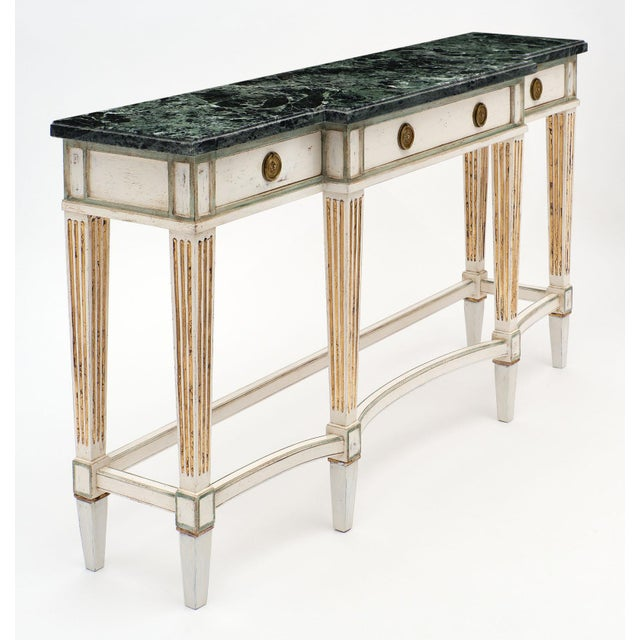 Elegant Directoire style console table with Pietra Verde marble top, intact and original to the piece. It features three...