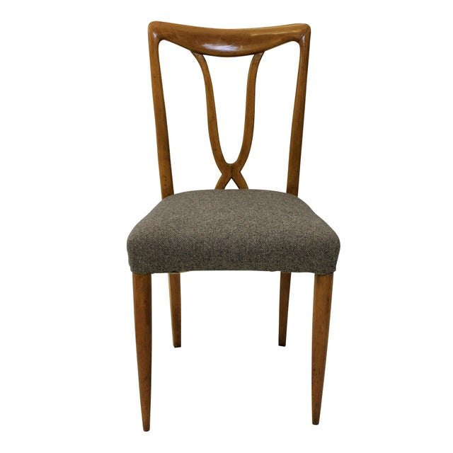 A set of six Italian dining chairs of stylish design in cherry wood. With sculptural backs and newly upholstered in wool.
