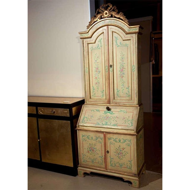 Attractive, Venetian-style painted secretary from the1960s, featuring an overall, light green-painted finish that has been...