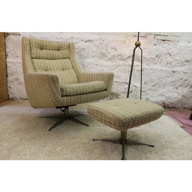 Mid-century modern period chair and ottoman upholstered in a nice tweed in cream with stripes. The legs detach from the...