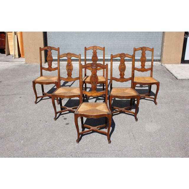 Set of six French country provincial dining chairs Circa 1910s. the dining chairs are in Solid walnut. Original rush...