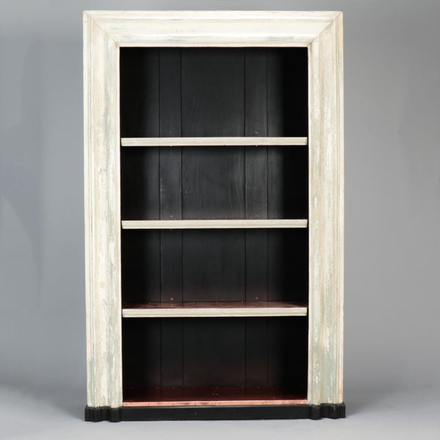 Large bookcase made from salvaged 19th century English door frame. Distressed creamy antique white painted door frame and...