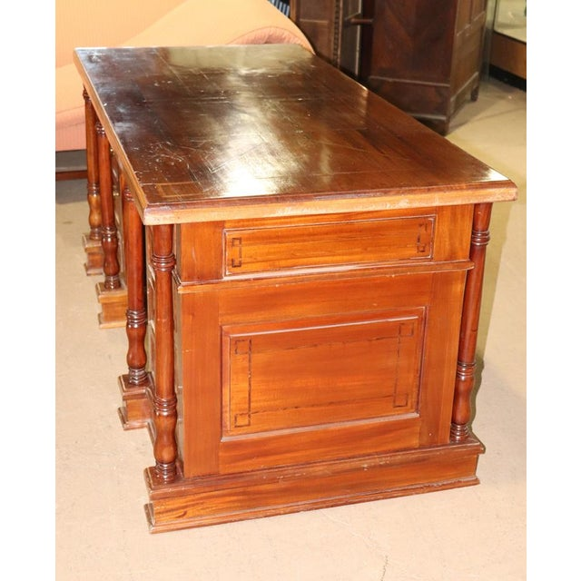 Italian inlaid walnut executive desk with 9 dovetailed drawers.