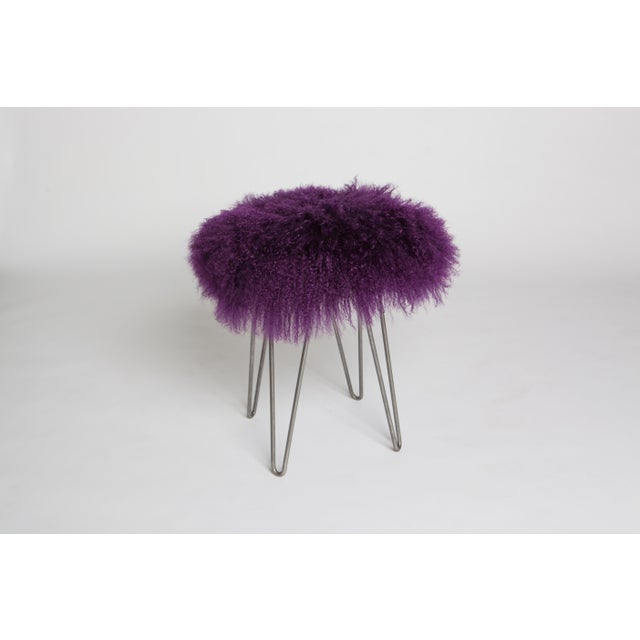 Topped with the wild, curly hair of a Tibetan lamb, this stool is eye-catching in any setting. It features a sturdy wood-...