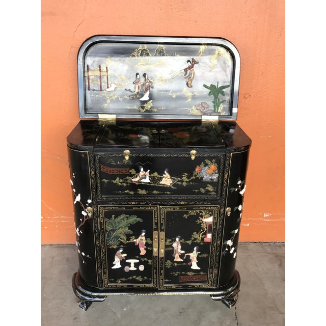 Chinese Black Lacquer bar with multiple doors and shelves having a carved hardstone designs of floral, birds inset into...