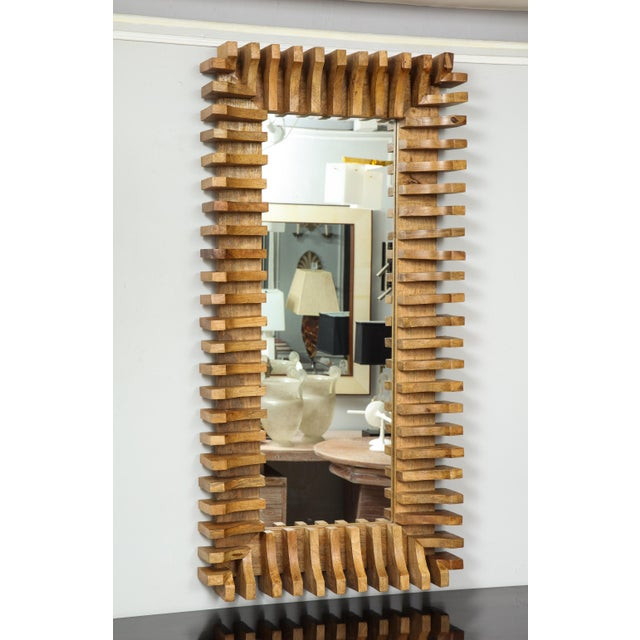 Unusual slatted wooden mirror.