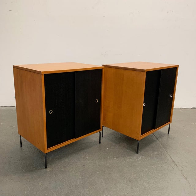 Pair of cabinets by Paul McCobb, Planner Group, Winchendon are solid natural maple with contrasting black grass cloth...