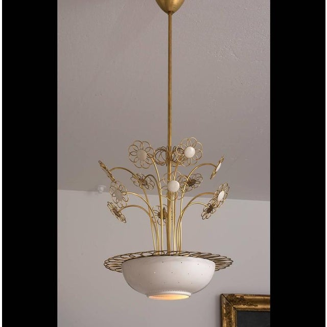 An elegant chandelier by Finnish designer Paavo Tynell for Lightolier. Executed in brass and white lacquered metal, this...