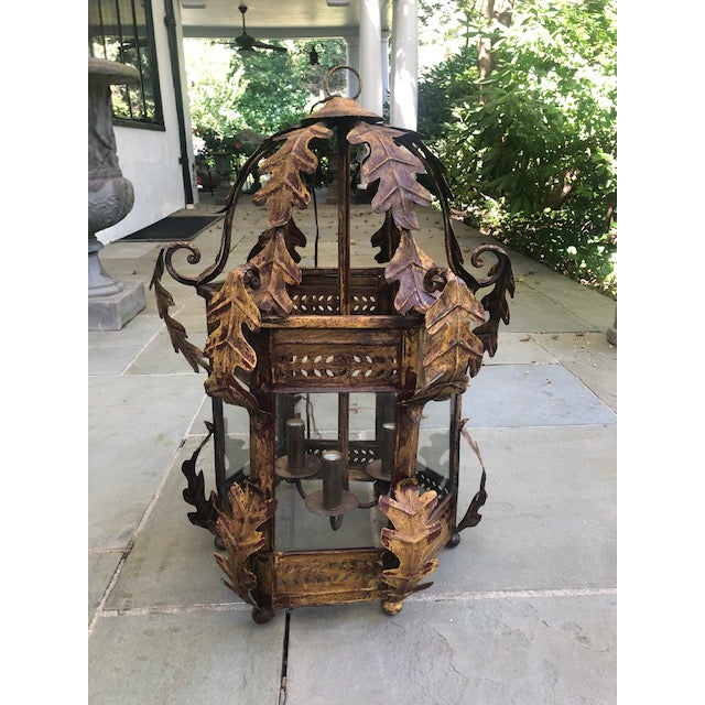 Large custom made, three-light hall lantern from Brooklyn studio Two Worlds Arts. Foliage design, glass panels, and footed...