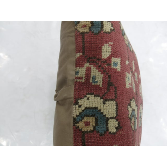 Pillow made from a vintage turkish rug with cotton back. Zipper closure and foam insert provided. 23'' x 24''