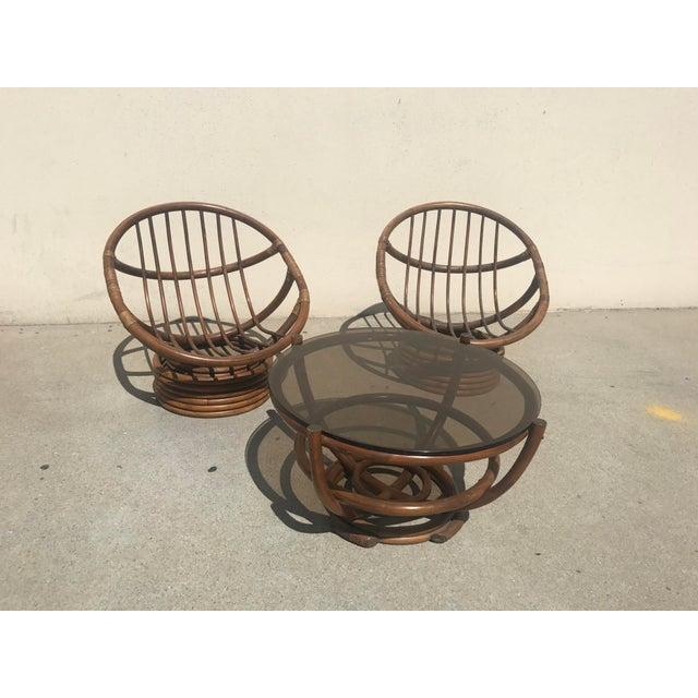 Beautiful pair of 1960's RATTAN PAPASAN SWIVEL ROCKING CHAIRS!! Medium brown stain, with matching smoky glass top round...