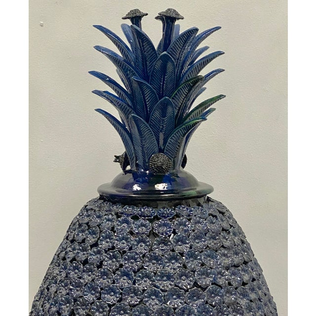 This is a very large terracotta blue pineapple in excellent condition. The body is comprised of small blue flowers, and...