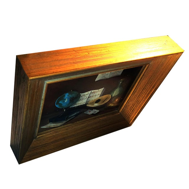 Small original oil painting on masonite board featuring a still life study that includes numerous elements. Among the...