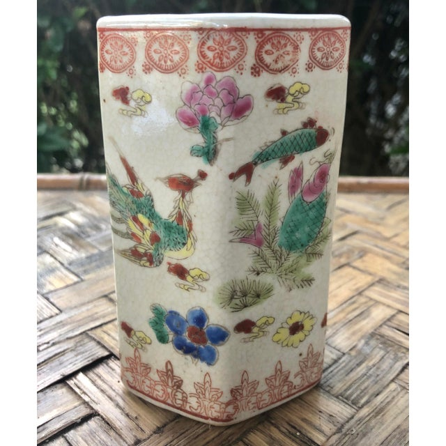 A lovely Chinese porcelain vase featuring traditional motifs throughout. This hexagonal vase has a stamped decorative...