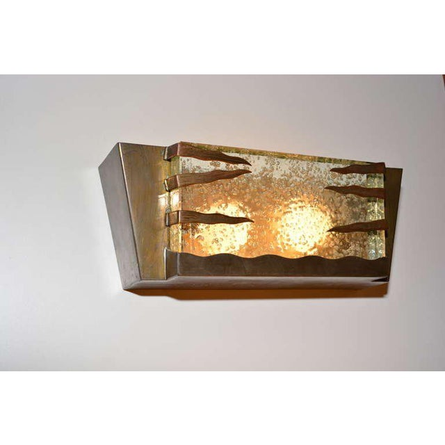 For your consideration a vintage Italian wall sconce constructed with brass frame and three strips of brass securing the...