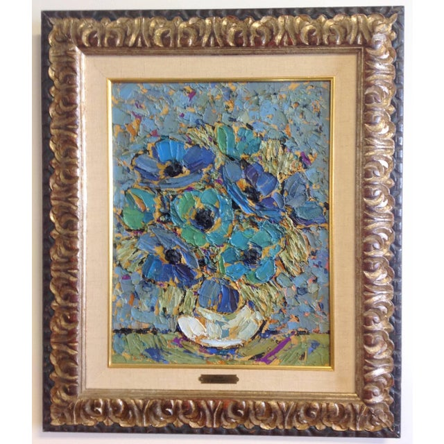 """Heavy impasto oil on canvas painting of blue anemones in white vase circa 1950s. Framed 26.5""""h x 22.5""""w. Sonia Mitrovich..."""