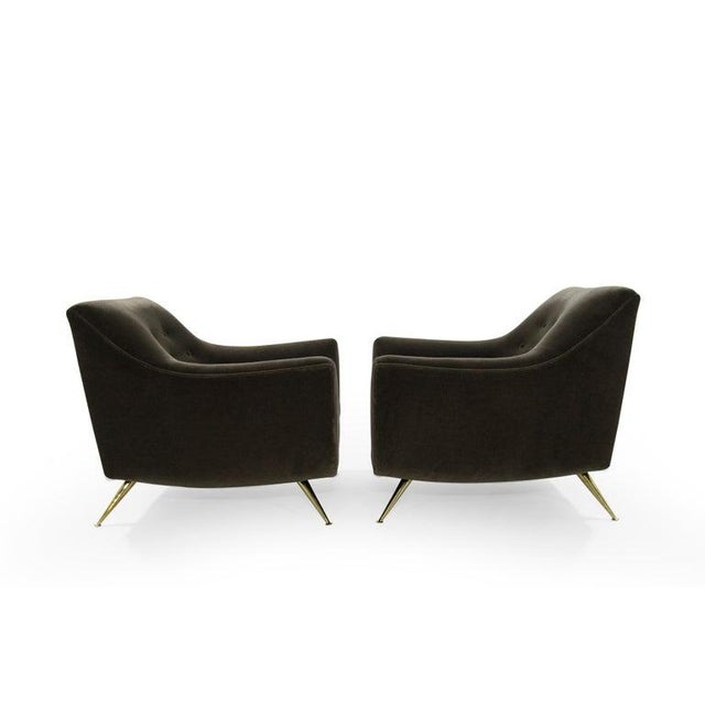 Pair of Henry Glass lounge chairs, newly upholstered in soft brown mohair. Chairs have been completely restored to their...