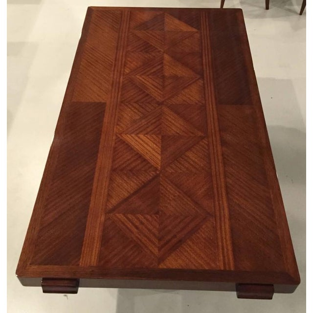 Stunning French Art Deco masterpiece dining table is by designer Gaston Poisson. The solid mahogany wood is breathtaking...