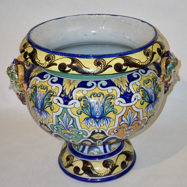 Circa 1875-1889, large two-part French Provincial faience jardinière / planter, entirely hand painted, with its matching...