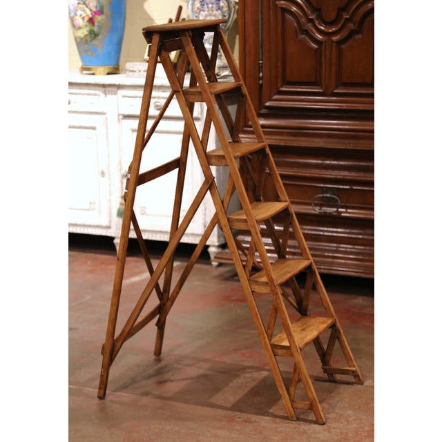 Crafted in France circa 1880 and made of walnut, the stairs features six graduated steps to one side and connected to the...