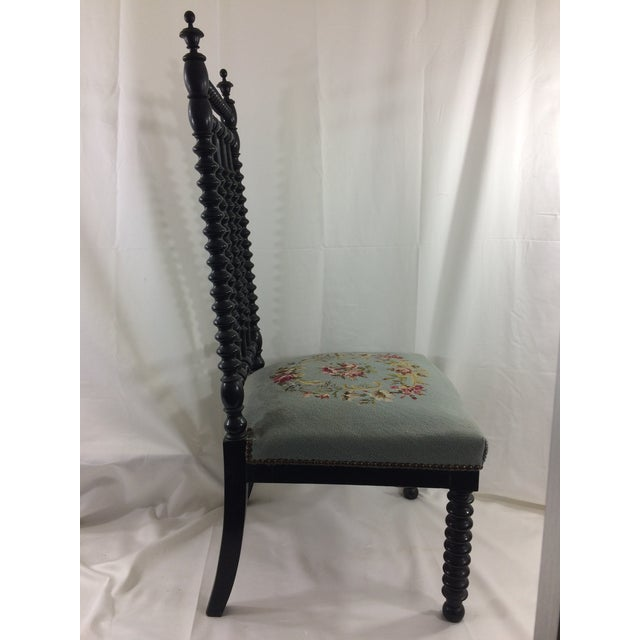 This fantastic spindle chair is ebonized wood with fantastic needlepoint style upholstery. Dating from the 19th century,...