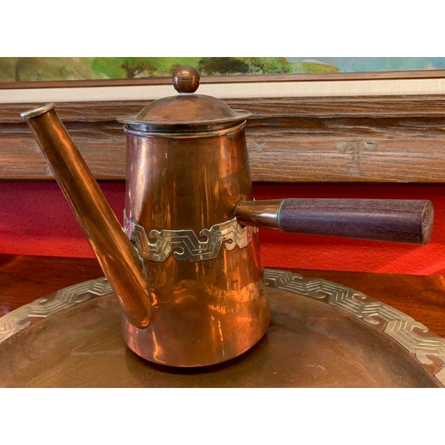 Four piece, hand crafted, copper and silver coffee set made by Artesanias. Coffee pot, milk pot, sugar bowl, and tray....