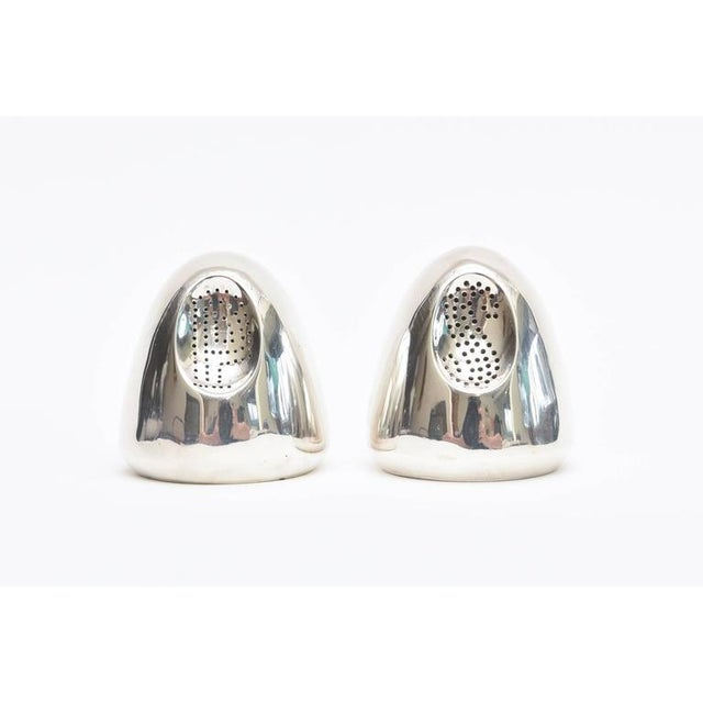 This lovely pair of hallmarked modernist sterling silver salt and pepper shakers is by the noted Mexican silversmith;...