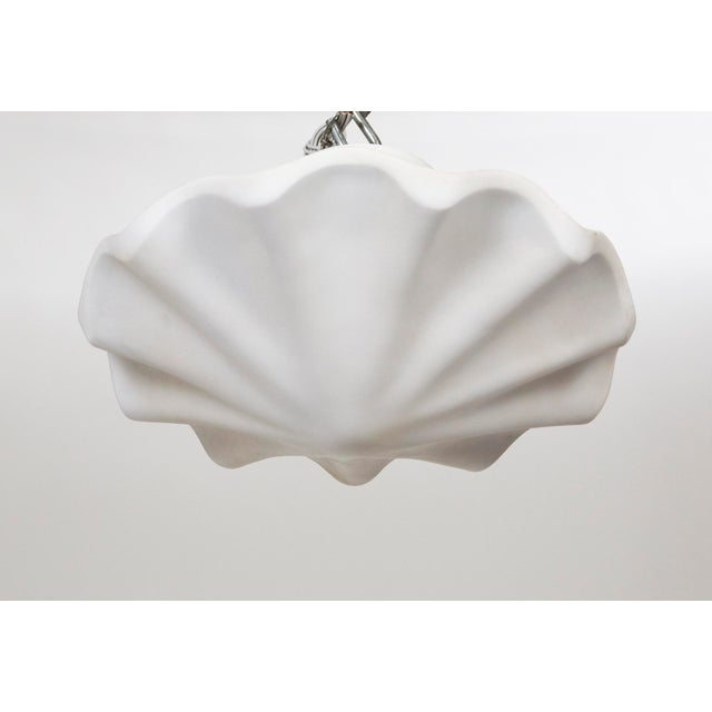A lacquered plaster pendant in a smooth, undulating shell shape, with scalloped edges. A newer take on Francis Elkins's...