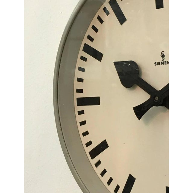 Steel painted clock with glass made in Germany in the 1950s. Formerly a slave clock, it is now fitted with a modern quartz...