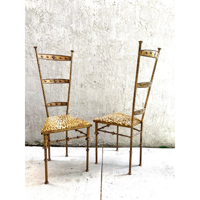 A pair of gilt metal chairs in the style of Giacometti. Beautiful details and shape. Patina to finish is wonderful.