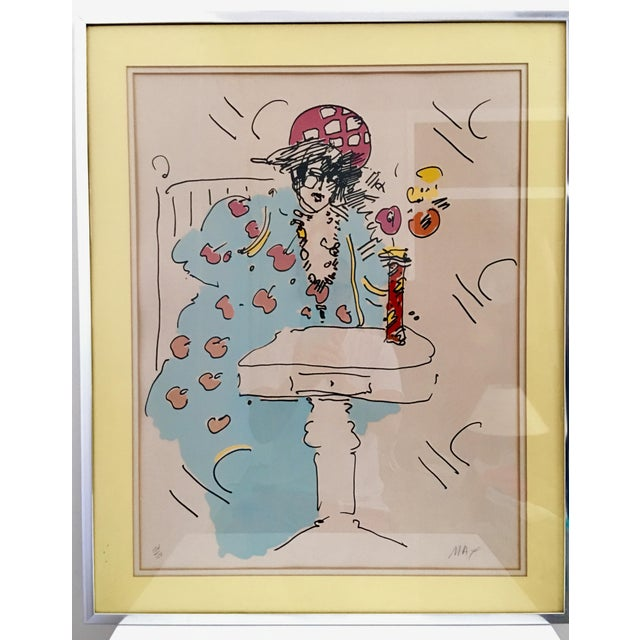 Peter Max limited edition lithograph of a woman at a small table. A uniquely personal example of his work. Pencil signed...