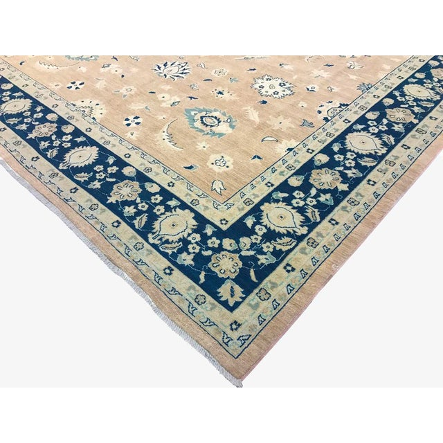 Gorgeous washout neutral Light brown with blue hues makes a sophisticated statement in any décor. This hand-knotted wool...